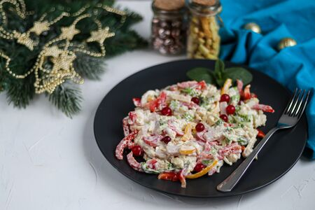 Salad of crackers, Peking cabbage, sweet pepper, hard cheese, balyk. Dressed with mayonnaise sauce. Garnished with cranberries. Festive, New Year's dish. High-calorie, nutritious. Copy space.