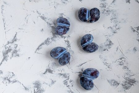 Ugly fruits. In this case, plums fused together. Tasty and healthy food. Copy space.