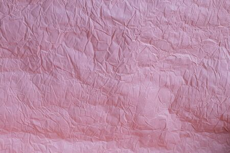 Background from pink crumpled wrapping paper. Congratulatory banner, card. Copy space.