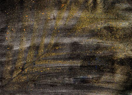 Abstract image. On a dark background, a palm leaf is traced in gold. Used for backgrounds, for cards and banners. The horizontal location. Copy space.