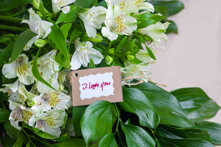 A bouquet of lilies on a light background. Mother's Day, Women's Day, Valentine's Day or Birthday. Copy space. Stok Fotoğraf - 163747030