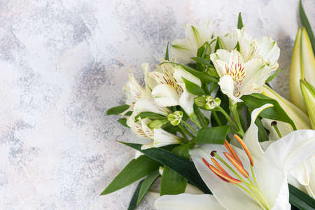 A bouquet of lilies on a light background. Mother's Day, Women's Day, Valentine's Day or Birthday. Copy space. Stok Fotoğraf - 163747039