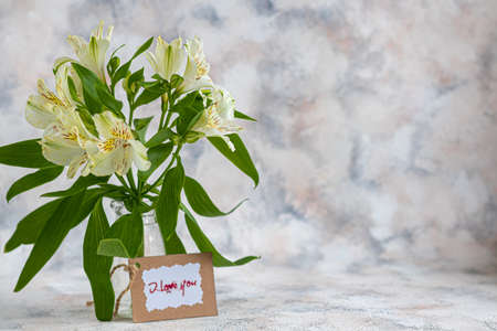 A bouquet of lilies on a light background. Mother's Day, Women's Day, Valentine's Day or Birthday. Copy space. Stok Fotoğraf - 163747040