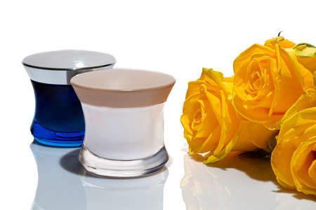 Lightweight plastic jars for creams. On white background. Hard shadows. Isolates. Gift concept. Copy space