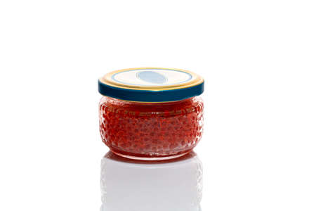 Red caviar on a white background. Isolate. Healthy food concept. Copy space.