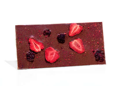 Chocolate bar with fruits on a white background. Gift concept. Isolate. Copy space.