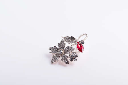 Bijouterie and jewelry on a white background. Brooches and hairpins, earrings and pendants. Isolate. Copy space