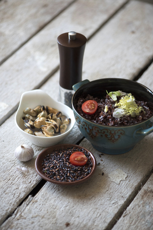 mussels: Mussels and black rice Stock Photo