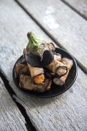 red braised: Rolls of eggplant stuffed with carrots and nuts Stock Photo