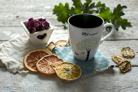 potpourri: Cup of warm tea and dried fruit Stock Photo