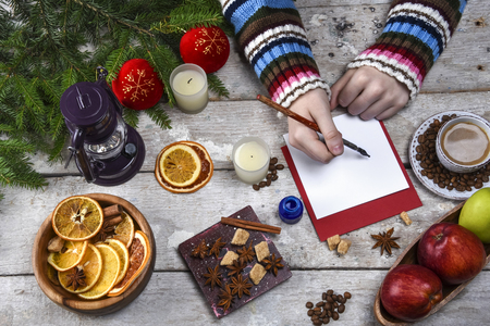 Coffee, dried fruits, apples, candles, hands, Christmas, place for text