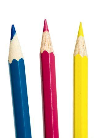 prepress: Cian, magenta y amarillo l�pices aisladas sobre fondo blanco. Puede utilizarse como s�mbolo abstracto de separaci�n de colores en la preimpresi�n.