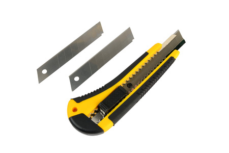 blades: Yellow construction knife with blades Stock Photo