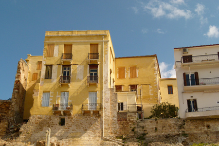 New buildings in Chania are built on the foundations of old yellow brick buildings, Crete