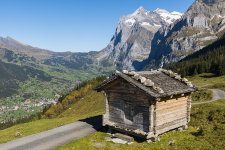 berner: Cabin in the Alps in Switserland in Grindelwald with in the background the Wetterhorn. Editorial