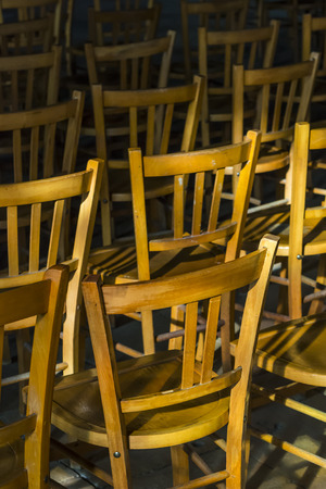 theology: Chairs with sun in a church in France. Stock Photo