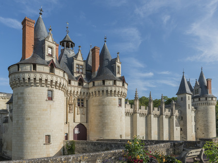 Great Chateau Castle of Dissay in France with several towers and bridge.