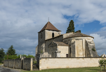 theology: Church of Tayac and Francs  with blue sky and rain clouds.