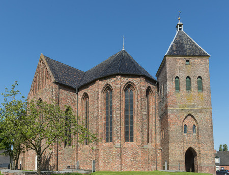 theology: Church of Zeerijp with blue sky and tower in the province of Groningen. Stock Photo
