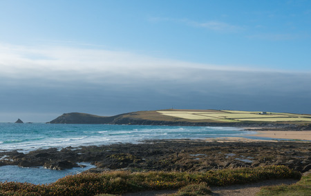 cropland: Coast with rocks in Cornwall with hills and cropland in England.
