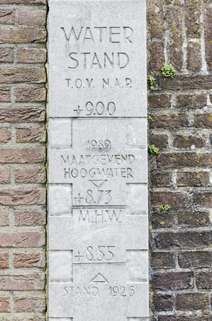 water level: A stone water level indicator with historical dates of high water in the twon of Wijk bij Duurstede near the harbour.