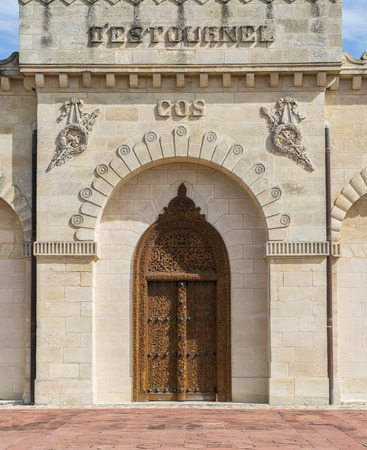 wood carving door: Door with wood carvings of Chateau Cos d Estournel