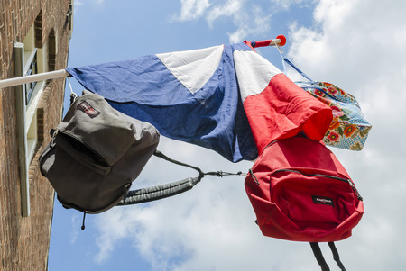 Dutch flag with three bags hanging on it in the town of Wijk bij Duurstede.