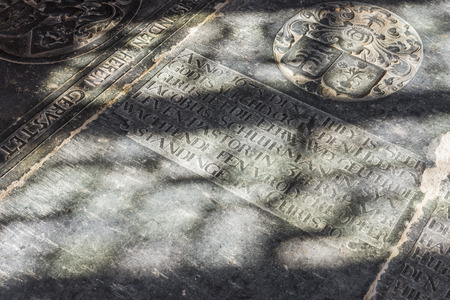 theology: Gravestone in the light of a church window of the church of Zeerijp in the province of Groningen. Stock Photo