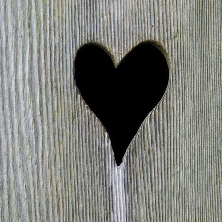 Heart in a outdoor wooden toilet door. photo