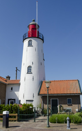 flevoland: The great tower and white and red lighthouse of the former island Urk in Flevoland, The Netherlands. Stock Photo