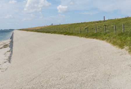 texel: Great dike at the Wadden Sea near the village of Oudeschild on the isle of Texel. Stock Photo