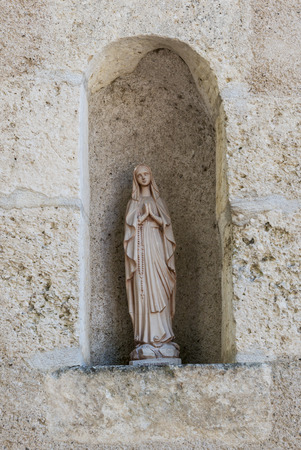 theology: Small Maria statue at the church of Pouilly sur Loire. Stock Photo