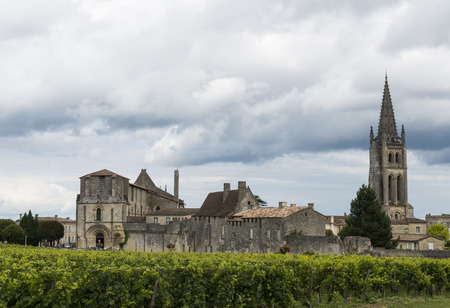 Church and village of Saint-Emilion in Winedistrict with vinyards.
