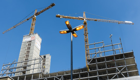 buildingsite: Two cranes and a lamppost at a buildingsite in Utrecht, The Netherlands Editorial