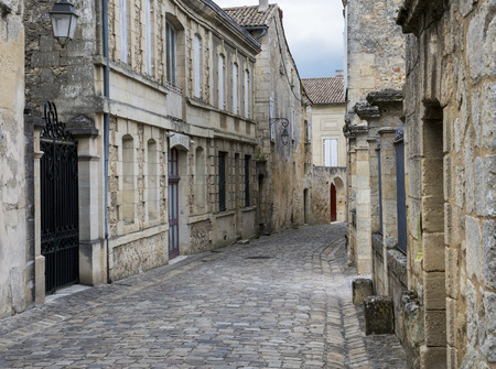 saint emilion: Old Street with cobble stones ands old stone houses in the wine city of Saint-Emilion. Editorial