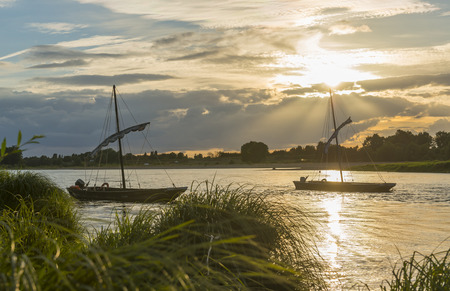 Two typical Loire boats on the river in France during sunset. 스톡 콘텐츠