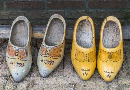 klompen: Two old pair of wooden shoes.