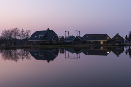 drakes: Frams at the Kromme Mijdrecht in Woerdense Verlaat after sunset in blue hour with refelcetion in the water.