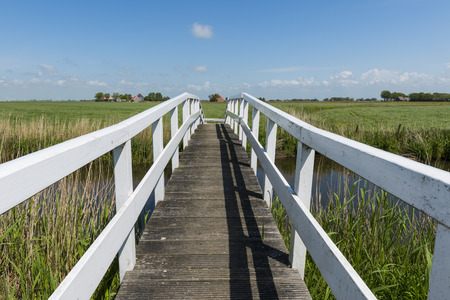 friesland: Picturesque white bridge for hikers in summer at Workum in Friesland province near Lemmer The Netherlands image Daan Kloeg Commee Stock Photo