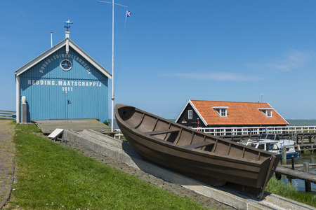 lemmer: Rescue Quad Hindeloopen with old boat and harbor buildings in Friesland province near Lemmer The Netherlands image Daan Kloeg Commee