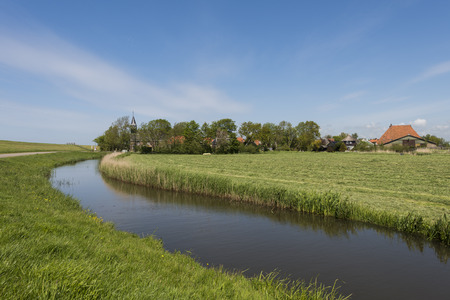 friesland: Picturesque village Gaast in summer in Friesland province near Lemmer The Netherlands image Daan Kloeg Commee Stock Photo