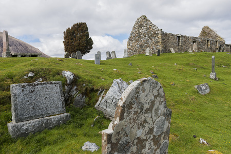 gravestones: Graveyard with chapel and gravestones near Loch Cill Chriosd in the Highlands of Scotland image Daan Kloeg Commee.