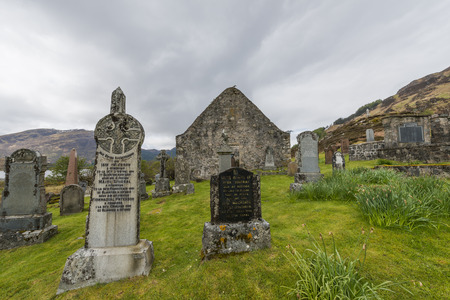 burried: Graveyard and Chapel in Ault A39Gruinn in the Highlands of Scotland with lake snow and piles of stone image Daan Kloeg Commee Editorial
