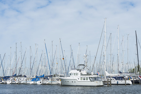 friesland: Harbor or Hindeloopen with many yachts i Friesland province in The Netherlands image Daan Kloeg Commee Editorial