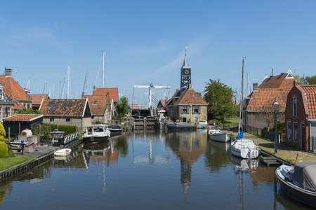 friesland: Picturesque harbor and church buildings in Hindeloopen at the IJsselmeer with in Friesland province near Lemmer The Netherlands image Daan Kloeg Commee