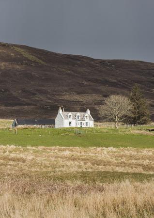 skye: House Isle of Skye in Scotland with dark sky.
