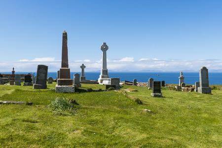 burried: Kilmuir graveyard with grave of knight Angus Martin near  the Skye Museum of Island Life, Scotland.