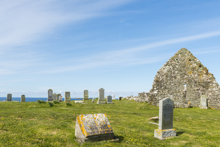 churchyard: Graveyard on Trumpan with grave stones and old chapel on the Isle of Skye in Scotland.