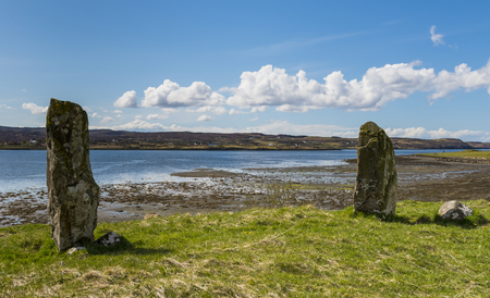 skye: Standing Stones  at Kensaleyre in Scotland with blue sky and ocean bay, Isle of Skye. Stock Photo
