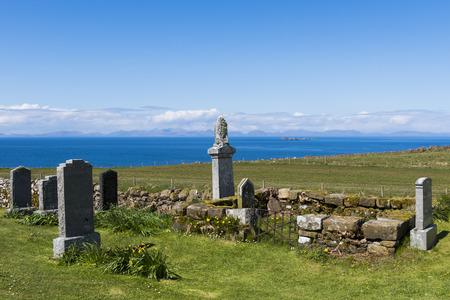 graveyard: Kilmuir graveyard with grave of knight Angus Martin near  the Skye Museum of Island Life, Scotland.